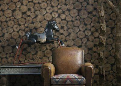 25238-lumberjack-timber-wallpaper-seat-cushion-in-tomahawk-brick-fabric-lifestyle