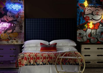 59078-sage-headboard-in-wales-navy-with-howard-steelleather-chest-of-drawers-a-cici-bar-trolley-and-micky-mouse-and-monopoly-man-neon-artwork-